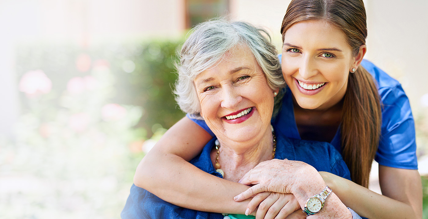 a resident and a caregiver outside